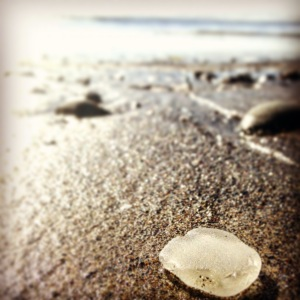Sea glass on sand. MomsicleBlog